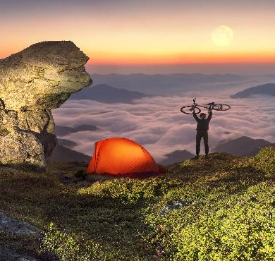 outdoor sky grass mountain sunset rock nature hiking rocky sunrise tent cloud orange landscape overlooking hillside distance person