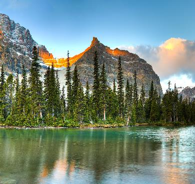 Larch Valley, Banff National Park, Alberta  outdoor tree nature snow sky landscape mountain water pond lake forest surrounded